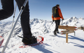 couple with snowshoes walking at Mountain Top